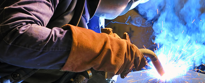 man welding with mask on
